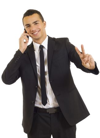 young businessman on the phone making his victory sign Stock Photo - 5837333