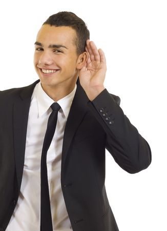 cant: Young business man cupping hand behind ear on white background - cant hear you concept
