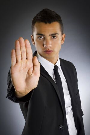 Portrait of a young business man with his hands on a dark background Stock Photo - 5837332