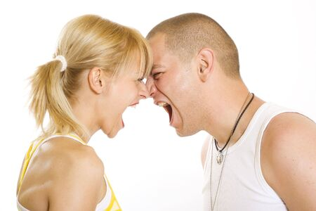 couple arguing: Angry twenty something couple yelling at each other