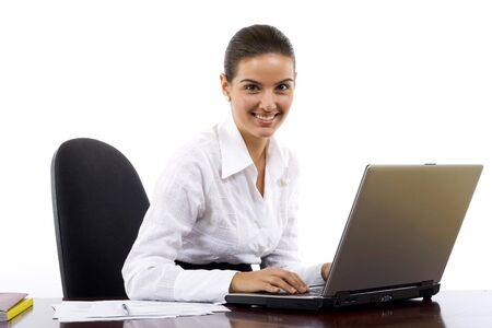 Portrait of an adorable business woman working at her desk with a laptop and paperwork. Stock Photo - 5941378
