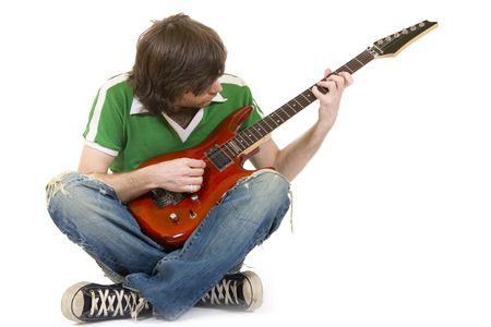 headbanging: picture of a seated guitarist playing an electric guitar Stock Photo