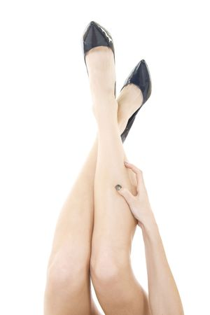 sexual selection: Sexy attractive female legs up with high heels isolated over white background Stock Photo