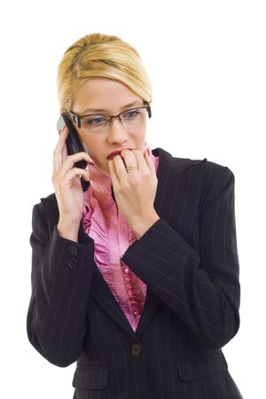 Worried businesswoman speaking by phone isolated on white. Stock Photo - 6049105