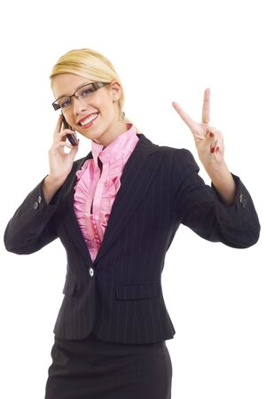 Happy businesswoman with phone and victory gesture, isolated photo