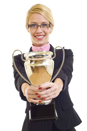 picture of an attractive businesswoman winning a trophy - focus on cup photo