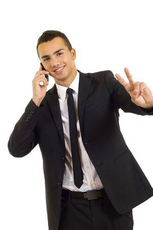 young businessman on the phone making his victory sign