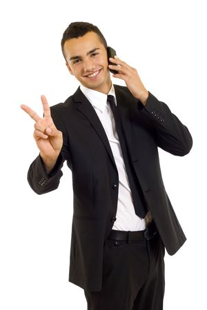 businessman on the phone making his victory sign over white Stock Photo - 6185071