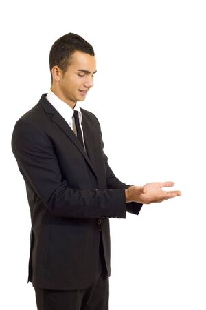 Young man showing something on his hands over white  photo