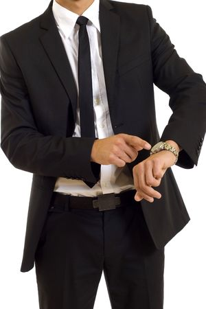 tardy: businessman looking and pointing at his watch