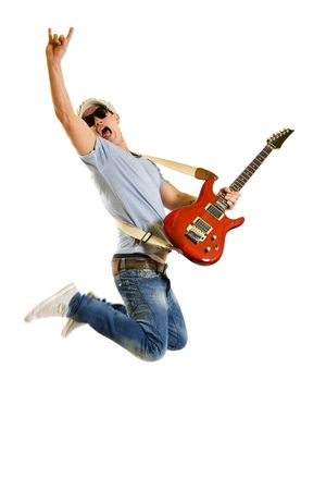 Passionate guitarist with sunglasses and hat jumps isolated on white