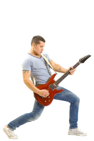 Shot of a young man playing his guitar with great emotions photo