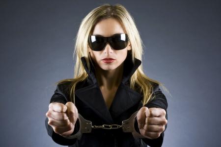 sexy woman wearing handcuffs photo