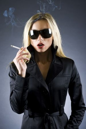 fashion style photo of a gorgeous blond woman holding a cigarette photo
