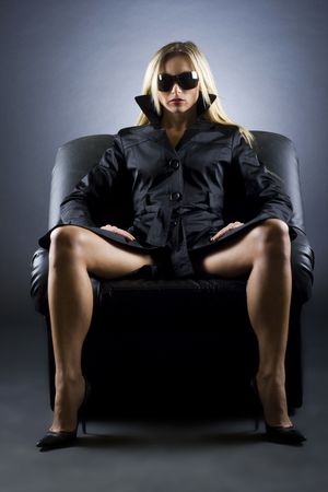 Gorgeous blond woman sitting on a luxury chair photo