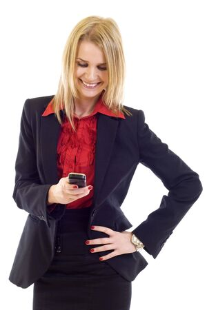 Young woman happily writing sms on a mobile phone photo