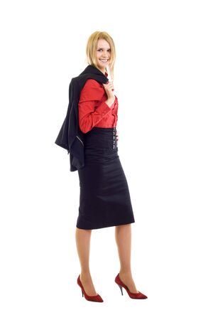 attractive businesswoman standing on a white background with coat on shoulder photo