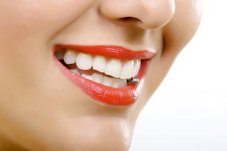 mouth close up: closeup picture og a womans tongue piercing over white  Stock Photo