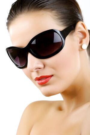 Woman in sunglasses glamour portrait over white  photo