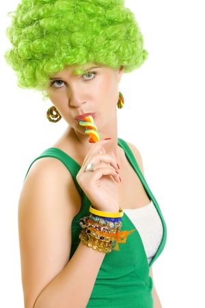 beautiful woman with green wig sucking on a lollypop  photo