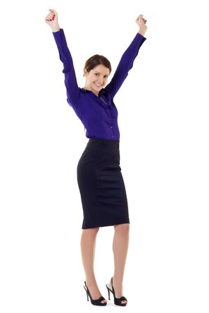 arms in air: a young business woman cheering with arms in the air  Stock Photo