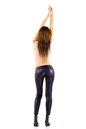 back picture of a sexy woman with hands up in the air photo