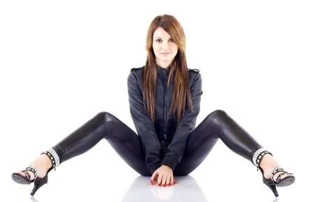 long pants: seated young girl with long hair, jeans and black leather jacket
