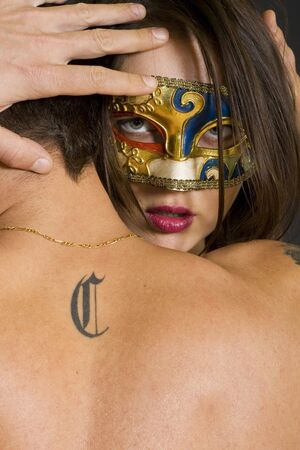 young couple in love,woman wearing a venetian mask Stock Photo - 6344661