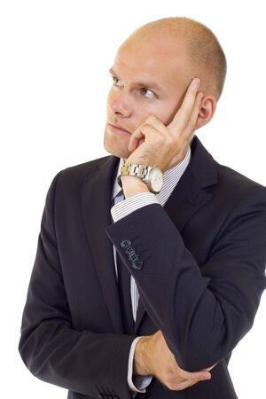 Worried businessman thinking and looking to a side over white Stock Photo - 6393820