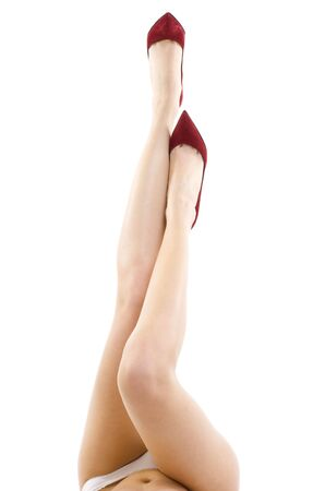 legs heels: Attractive sexy female legs with high heels isolated on white background