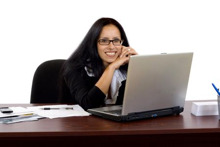 Portrait of an adorable business woman working at her desk with a laptop. Stock Photo - 6393894