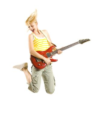 headbanging woman guitarist jumps  over white background Stock Photo - 6596811