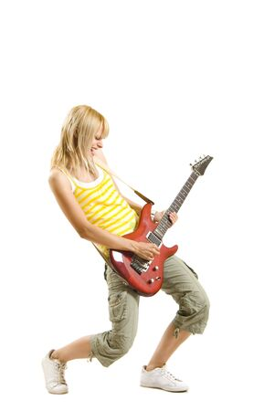 blond woman with guitar on white background  photo