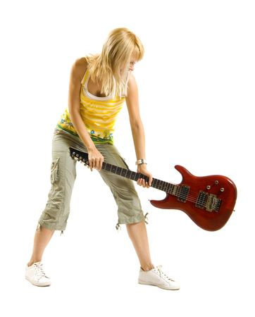 woman guitarist breaking her guitar  over white Stock Photo - 6596832