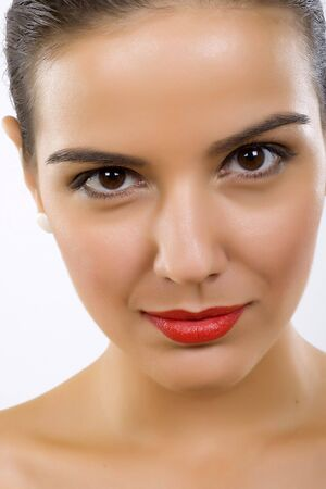Beautiful young woman face. Close up. over white  photo