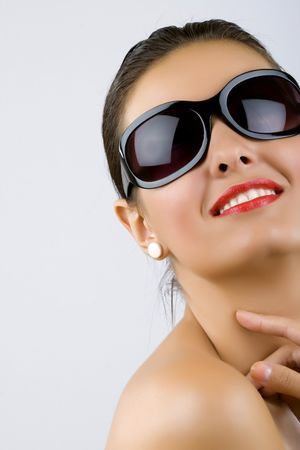 brunette portrait with sunglasses with nice make up photo