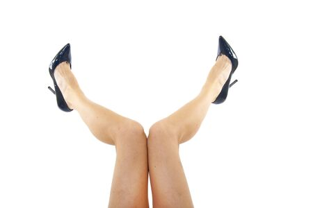 sexual selection: Sexy attractive female legs up with high heels isolated over white background
