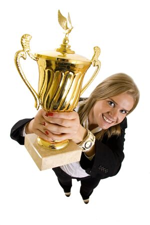 wide angle picture of an attractive businesswoman winning a gold trophy Stock Photo - 6596828