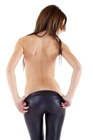 girl wearing leather pants, from behind, taking her pants off  photo