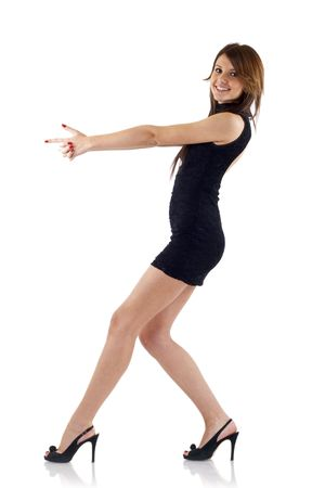 tight dress: sexy woman acting like shes going to shoot somebody Stock Photo