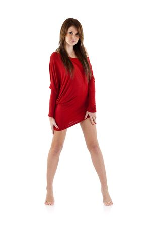 woman in red dress standing on white in bare feet Stock Photo - 6661786