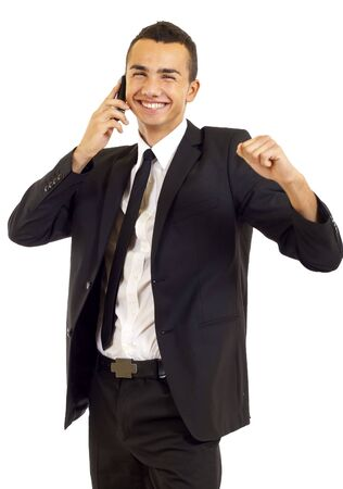 Successful surprised businessman with clenched fist using mobile phone. Celebrating some happy news Stock Photo - 6661856