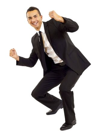 loudly: Portrait of young businessman shouting loudly with his arms widened  Stock Photo