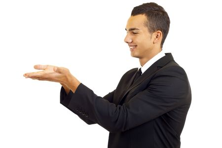 Young man showing something on his hand over white   photo