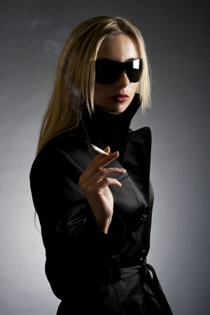 fashion style photo of a gorgeous blond smoking  a cigarette  photo
