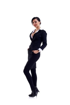 females only: Young happy businesswoman with hands in her pockets isolated on white  Stock Photo