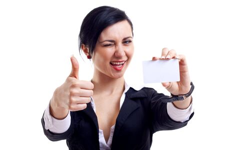 card making: Female holding blank business card, making ok sign and winking, focus on hands and card