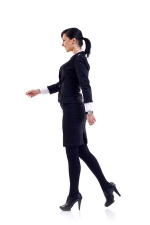 woman walking: business woman walking isolated over a white background