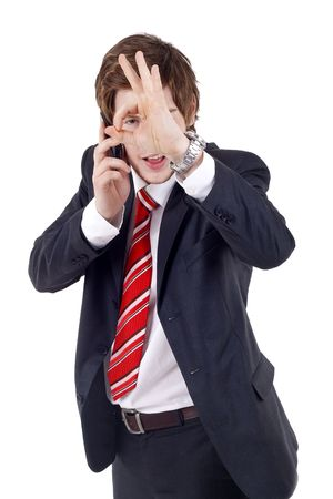 businessman on the phone approving the good news, looking through his finger sign