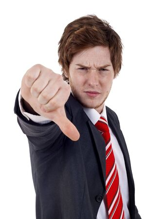 Businessman gesturing thumbs down over white background  photo